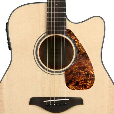 Vintage tortoise Yamaha acoustic pickguard on guitar
