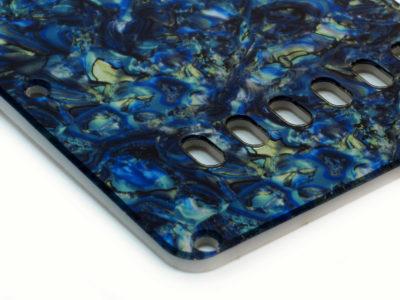 Blue abalone Stratocaster tremolo cover close